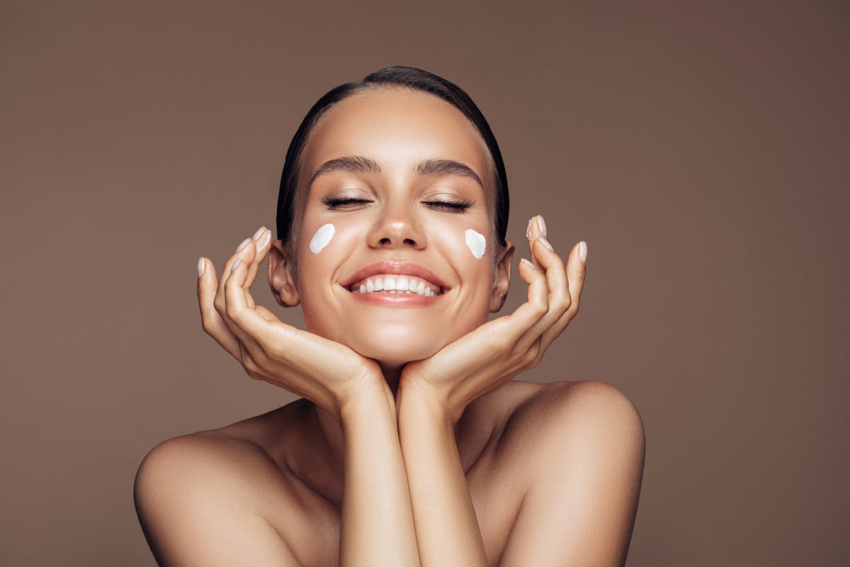 Woman Takes Care of skin Microbiome and Enjoys Healthy Radiant Skin