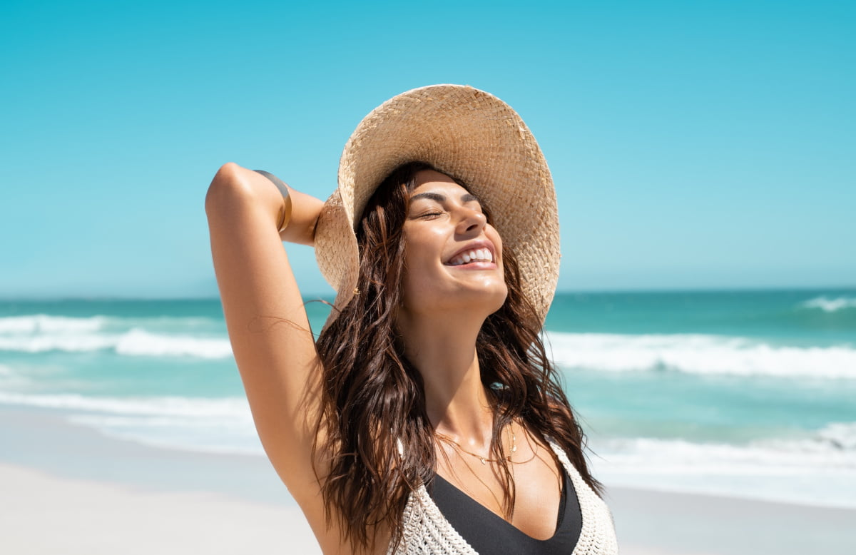 Young Woman Enjoys Beach after Non-Surgical Face Treatments with Dr. Duplechain
